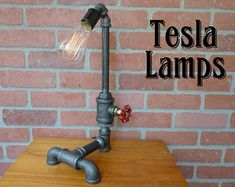 FAUCET HANDLE DIMMER!  Pipe lamp with faucet dimmer - handle controls flow of electricity instead of water - very cool