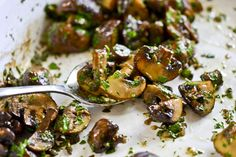 Roasted Mushrooms - these oven-roasted mushrooms are perfect for Fall and full of flavor thanks to garlic, capers, lemon juice and fresh parsley.