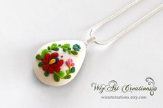 Handmade polymer clay pendant inspired by Hungarian kalocsai embroidery by WizArt Creations: wizartcreations.esty.com