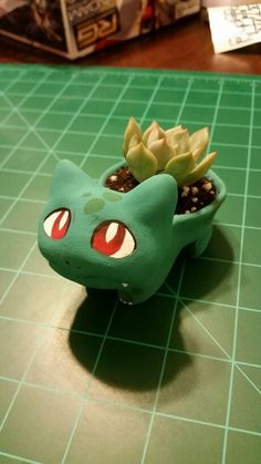Created by Lauren Balajadia  Little Bulbasaur Pokemon pot handmade from Crayola Air Dry clay and hand painted with Craft Smart acrylic paint. Any clay and acrylic paint would work! Finish up with a little succulent or mini cactus inside!!!