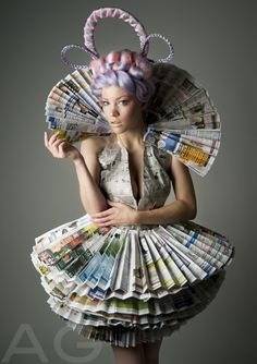 I've seen newspaper dresses before, but this one is amazing
