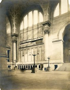 Workers hanging a map in Pennsylvania Station, photograph by Louis H. Dreyer, ca. 1910.  McKim Mead and White Architectural Records Collection, PR 042, NYHS Image #88312d.