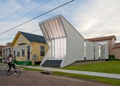 """""""Alligator House — This home was designed and built as a New Orleans re-housing project, post Hurricane Katrina. Although it's only 872 square feet, architects buildingstudio created a two-bedroom, one-and-a-half bath home to accommodate a family. Funded by donations, the home is an example of how low-cost structures can also be functional and comfortable."""""""