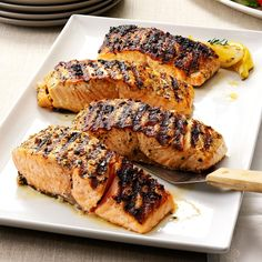 Grilled Lemon-Garlic Salmon Recipe -A lot of people fish for salmon here on the shore of Lake Michigan, so I've developed quite a few recipes for it, including this one. I love it, and so do my friends and family. When it's out of season, I look for wild-caught fresh Alaskan salmon at the grocery store. —Diane Nemitz, Ludington, Michigan