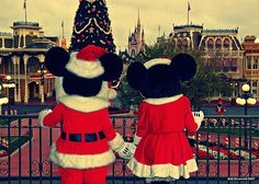 Mickey and Minnie holding hands at Christmas