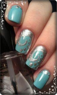 Swirls on turquoise nail art design