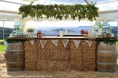 Lovely vintage wedding bar set up using oak barrels now available for hire from http://devonvintagechina.co.uk