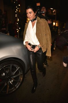 White button-up blouse (tucked in), black leather skinny trousers, black ankle boots, brown suede moto jacket, black bandana tied around neck