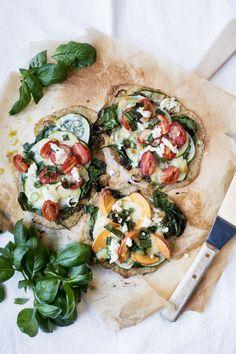 Summer Pizzas w / pesto, greens, zucchini, peach, tomato & mozzarella