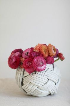 """THIS """"monkey knot"""" vase for the tables with the all floral centerpieces is SO CUTE. What do you think? *don't mind the flowers here* Monkey Knot, Style Me Pretty Living, Diy Braids, Rope Crafts, Beach Crafts, Pretty Designs, Sisal, Celtic Knot, Coastal Decor"""