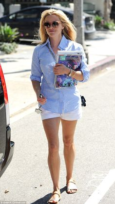 Bye bye Rome!Reese Witherspoon was beating the post-holiday blues on Saturday as she hit ...