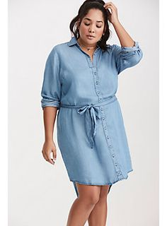 "This hi-lo button front shirt dress has Americana fever with a lighter wash chambray that is a silkier, softer and lighter alternative from denim. A removable waist tie lets you play up your proportions.<div><br></div><div><b>Model is 5'10"", size 1<br></b><div><ul><li style=""list-style-position: inside !important; list-style-type: disc !important"">Size 1 measures 42"" from shoulder</li><li style=""list-style-position: inside !important; list-style-type: disc !important"">Tencel</li>..."