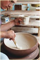 Close-up of working at the wheel--Paul Linhares--FANTASTIC pottery website