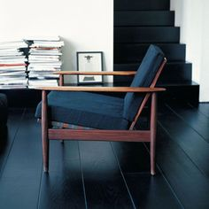 The chair, the painted floorboards, the piles of magazines...