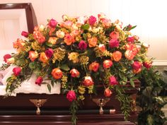 Casket spray of 100 mixed roses in red and two varieties of bi-color red/yellow roses with yellow wax flower. Casket Flowers, Wax Flowers, Funeral Flower Arrangements, Funeral Flowers, Romantic Flowers, Wedding Flowers, Funeral Caskets, Red And Yellow Roses, Funeral Sprays