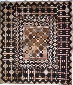 Framed Center Pieced Quilt, 1825 - 1850. Made by Rachel Burr Corwin. Smithsonian Institution.
