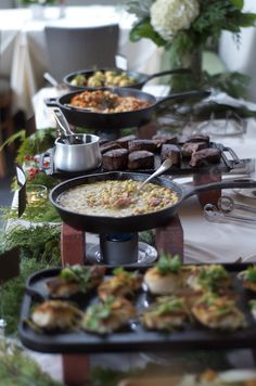 Food stations that we offer for private events in le Salon du Mistral cast iron pans, iron skillet, catering food stations, catering buffet ideas, brick, buffet set