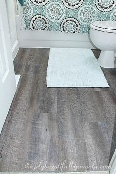Lay peel-and-stick vinyl flooring in your bathroom or another small room in your…