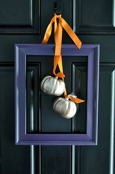 "What a simple way to adorn a door.  The creator of this knows how striking it is to use colors that are complimentary...orange and blue (or any variation of the two) are directly across each other on color wheels.  And since I love silver so much, this easily became my favorite ""simple"" decoration."