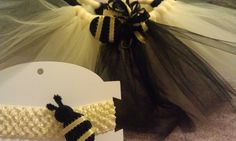 Bumble bee tutu set  http://www.facebook.com/#!/pages/Sweetie-Pie-Designs-by-Amanda/151835748188004