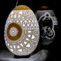 Slovene Lace - This design reflects the lacework that has inspired much of Grom's egg-carving art. The attention to fine detail and the repeating patterns echo the craftsmanship that goes into traditional Slovenian lace making.