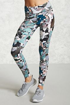 A pair of knit athletic leggings featuring an allover abstract print, side mesh panels, a hidden key pocket, and moisture management.