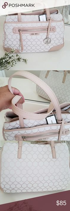 "Nine West Handbag Beautiful brand new with tag Nine West Handbag. Light beige. No major stains or damages. One little spot near the zipper area of the front pocket. You can see it in the cover photo. One snap button closure pocket and one zipper pocket on the outside. There big compartments in the main bag. Middle section has zipper closure while the two on either sides have magnetic button closure. Faux leather and canvas type fabric. Nylon type material inside. Approx 13"" x 9"" x 4 1/4""…"