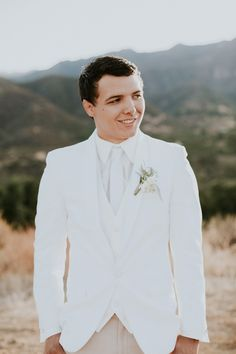 All white groom style | Image by JC Guzman Photography