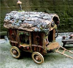 Fairy house wagon for 'The Traveler Fairies.'  They sell wares to those they pass by, tell fortunes, camp, sing and dance around the fire in fairy villages they visit along the way. They're welcome to park their wagon near your village!