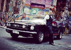 Mustangs in Black 1966 GT Convertible Ford Mustang in Melbourne's Hosier Lane for Joe and Zahra's wedding shoot - photo by Sakhi Photography.