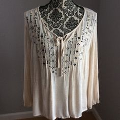 Dress barn top In pre loved condition. No rips or stains. This fit shorter on me then other dress barn tops. 2X nice tribal design and tie in the front. Dress Barn Tops Blouses