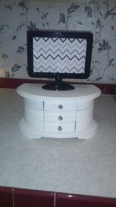Tv and tv stand. ( tv is picture frame from Michaels, tv stand is jewelry box from kmart) total cost: $9