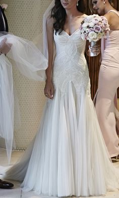 Tivoli gown by Baccini & HillBeautiful french lace has been used on this dress, structured on the bodice to make it flattering for any shape! The d...