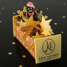 Noël 2013 - Bûche Rêves de Noël - Eric Kayser. L'artisan-boulanger Eric Kayser fait référence à ses souvenirs d'enfance et ses origines alsaciennes avec cette bûche composée d'un biscuit spéculoos, d'un crémeux à la fève de tonka et d'une mousse au chocolat noir 62%. Petit bonhomme en pain d'épices. 6 personnes : 50 euros.