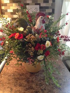 Rooster Flower Arrangement. by LSJHomeDecor on Etsy https://www.etsy.com/listing/219647102/rooster-flower-arrangement