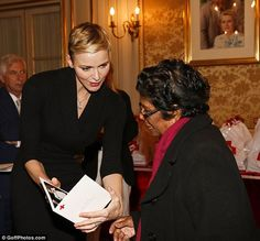 Princess Charlene of Monaco visits Red Cross HQ in Monaco to hand out parcels to those in need
