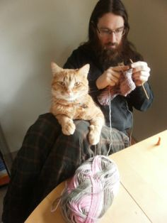 """cuteboyswithcats: """" a typical sunday: my boyfriend tom, knitting with the assistance of his adorable cat ferdinand. -anna panda """""""