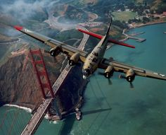 "The restored Boeing B-17G ""Nine O Nine"" flies over the Golden Gate Bridge in San Francisco."