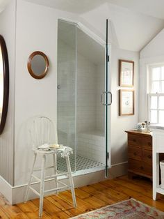 A steam shower in this master bath makes smart use of a sloped-ceiling space with a built-in bench underneath Attic Bathroom, Steam Showers Bathroom, Upstairs Bathrooms, Dream Bathrooms, Small Bathroom, Bathroom Ideas, Master Bathrooms, Basement Bathroom, Washroom
