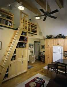 Space saving narrow loft stair design with built in storage.