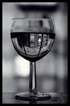 Reflection Photography i think is a really interetsing form of photography, the images created are always interesting even if its just a glass of wine.. there is always something thats eye catching...