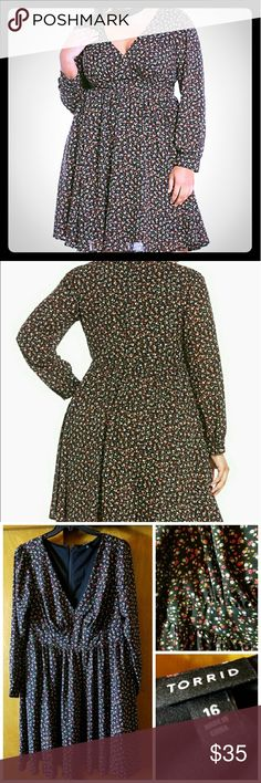 Black Floral V-neck Georgette Fit n Flare Dress The V-neck in this black beauty adds a little sexiness to this flirty dress. Perfect for a Spring/Summer evening. Size 16. Torrid Dresses Midi