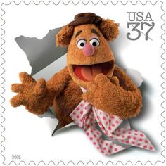 "Congratulations to the Muppets, who received a star on the Hollywood Walk of Fame pn March 20, 2012 As Fozzie the Bear famously once said: ""If you stick to something, you can get anywhere…especially when you're a stamp! Wocka wocka!"""