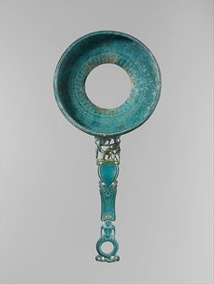Bronze strainer with openwork handle, 5th cent. BCE. Metropolitan Museum of Art.