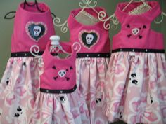 XXS, XS, Sm, med Harness dresses with cute white skulls on pink background and hot pink top. $24.99, via Etsy.