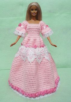 This sweet-looking pink crocheted dress for Barbie is made from good-quality acrylic yarn With the beautiful details of laces and numerous pink roses, this dress can turn your doll into a princess!  Doll is not included.