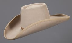 """James Arness's Gunsmoke Stetson Hat  A James Arness """"Matt Dillon"""" Stetson. A fine 5X hat with evidence of strong make up residue. Inside tag reads, """"Made by Stetson Especially for James Arness.""""   James Arness played the role of the iconic Marshall Matt Dillon on Gunsmoke for twenty years, and has the distinction of having played the character in five different decades."""