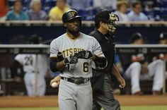 Starling Marte of the Pittsburgh Pirates walks towards the dugout after striking out in the first inning during the game between the Miami Marlins and the Pittsburgh Pirates at Marlins Park on June 2016 in Miami, Florida. Miami Marlins, Pittsburgh Pirates, Starling, Miami Florida, Boston Red Sox, Walks, June, Baseball Cards, Sports