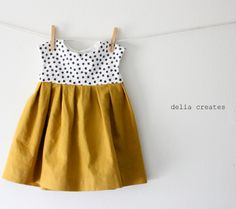 I admit it would be fun to dress a little girl, especially in one of these adorable handmade dresses. Some of them are easy enough I could make them!