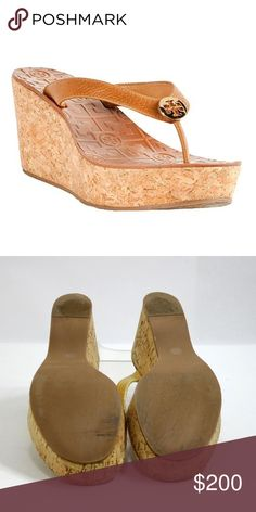 Tory Burch Tan 'thora' - 7/ 37 Wedges Recognized for her trademark interlocking T's, Tory Burch designs products to fit her own active lifestyle, making them ideal choices for the busy, independent woman with little time to fuss over pricey accessories. Tory Burch Shoes Wedges
